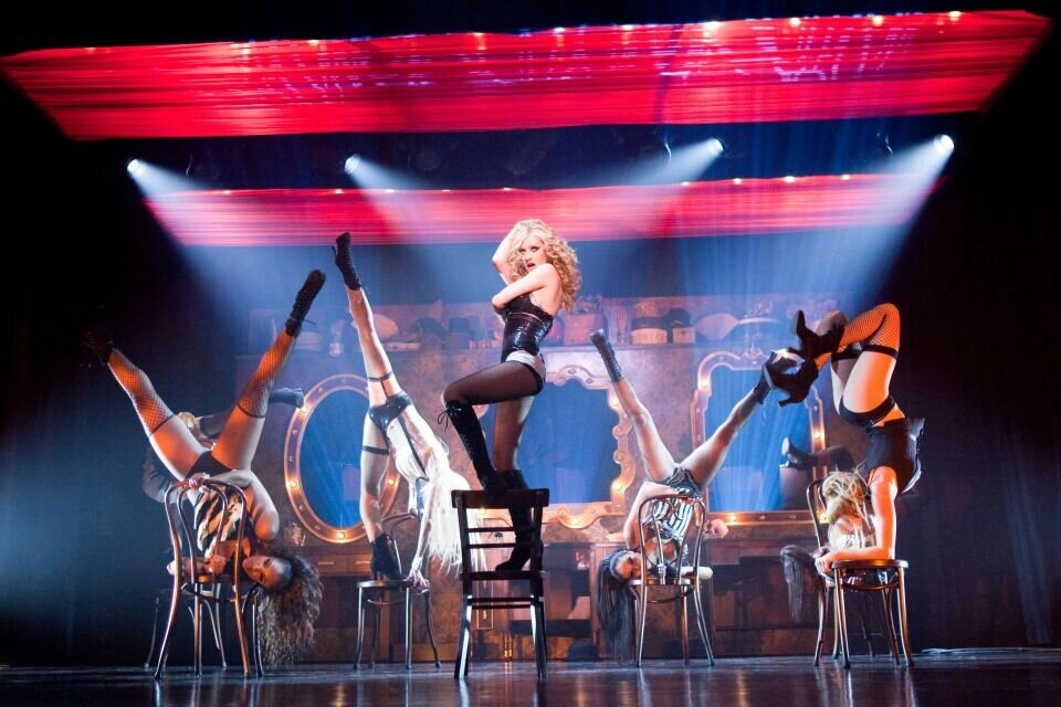 burlesque 'an oscar-nominated actress as well as a burlesque queen, west's self-indulgence is the stuff of legend' 'the roster of tattooed, pierced misfits and post-punk gals has become a phenomenon with a recent burlesque revue touring north america.